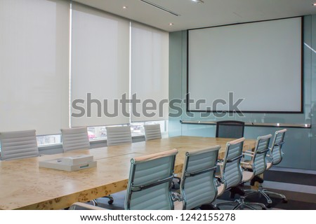Meeting room with white curtain, shutters, blind, roller. #1242155278
