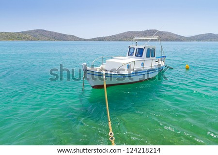 Small fishing boat at the coast of Crete, Greece #124218214