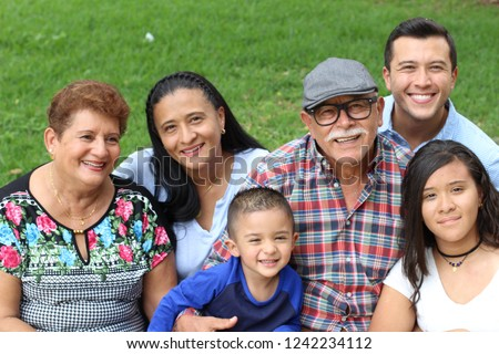Hispanic family with good values  Royalty-Free Stock Photo #1242234112