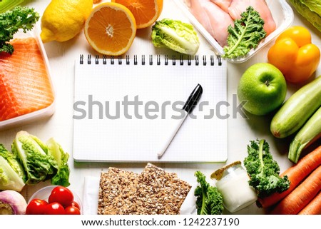 Healthy eating plan. Diet and meal planning. Top view. Flat lay #1242237190