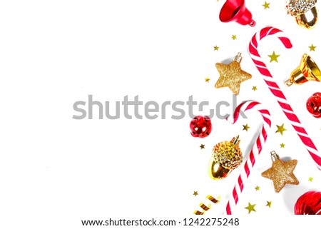 Christmas mood concept. Layout composition w traditional festive attributes, balls, candy canes, stars & other decorations. Winter holidays season. Background, copy space, close up, top view, flat lay #1242275248