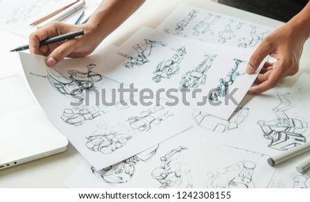 Animator designer Development designing drawing sketching development creating graphic pose characters sci-fi robot Cartoon illustration animation video game film production , animation design studio. #1242308155