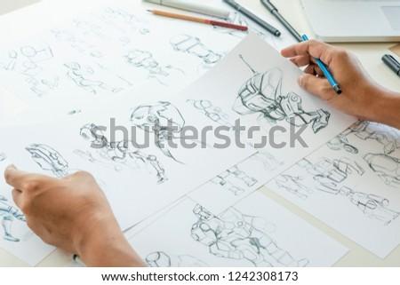 Animator designer Development designing drawing sketching development creating graphic pose characters sci-fi robot Cartoon illustration animation video game film production , animation design studio. #1242308173