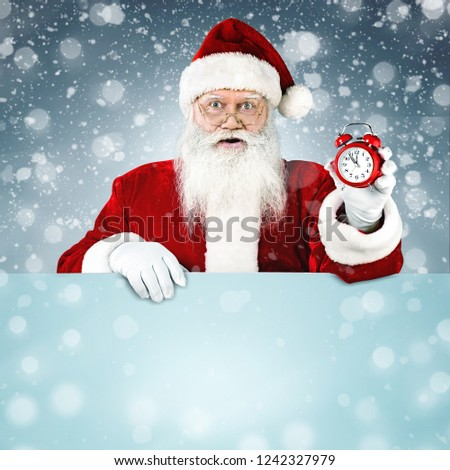 Santa Claus pointing in blank advertisement banner with copy space #1242327979