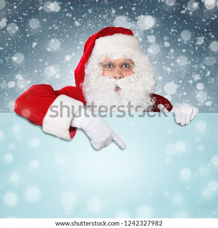 Santa Claus pointing in blank advertisement banner with copy space #1242327982