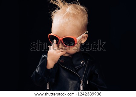 Born to be rock and roll star. Adorable small music fan. Little child boy in rocker jacket and sunglasses. Little rock star. Rock style child. Rock and roll fashion trend. Music for children. #1242389938