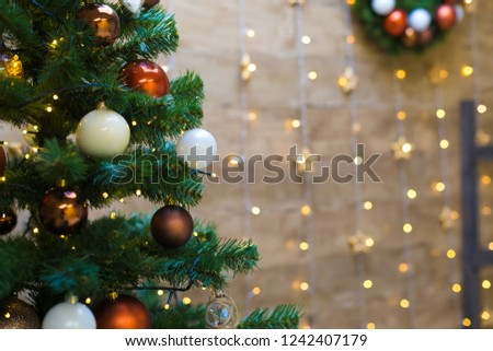 Beautiful winter card. Christmas tree decoration toys ball and lights. New Year holiday. Wonderful background event. Family interior celebration.  #1242407179