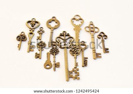 Decorative keys of different sizes, stylized antique. #1242495424
