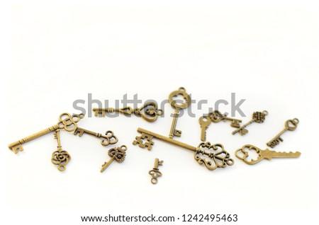 Decorative keys of different sizes, stylized antique. #1242495463