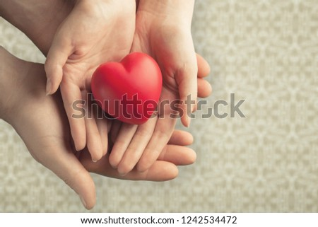 Young woman holding red heart, health insurance, #1242534472
