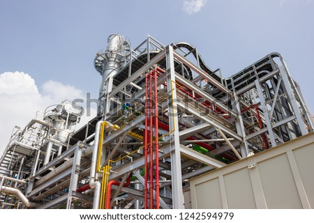Pipe Rack, Water Pipe, Gas Pipe, Cable Tray, Cable ladder, HRSG, Stack and etc. in Power Plant Royalty-Free Stock Photo #1242594979