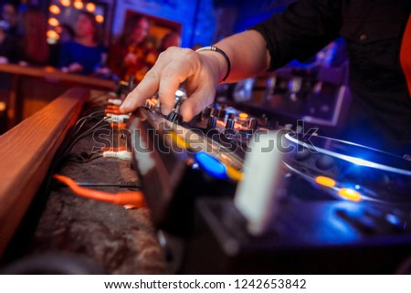 Dj mixes the track in the nightclub at party #1242653842