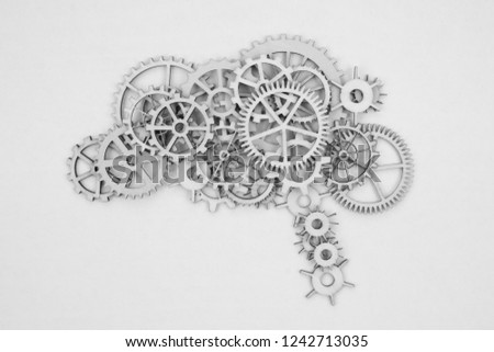 human brain out of gears. Isolated on white background. Business concept, thinking, ideas.
