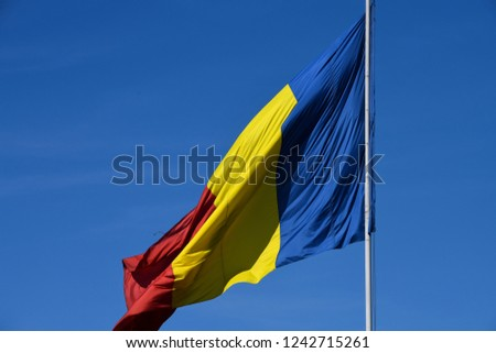 Romanian national flag in the wind on a sunny day. #1242715261