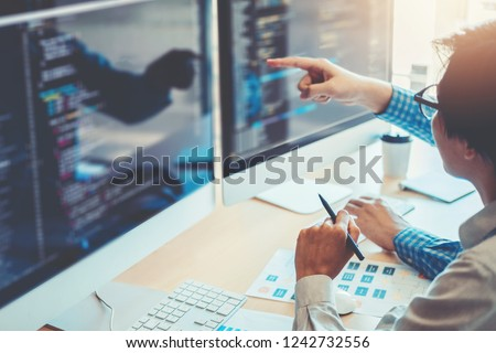 Developing programmer Team Development Website design and coding technologies working in software company office #1242732556