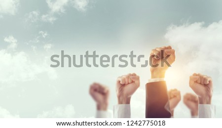 Hands of Business team raised fist air Corporate Celebration victory, success and winning concept, copy space. Royalty-Free Stock Photo #1242775018