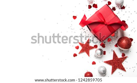 Merry Christmas and Happy Holidays greeting card, frame, banner. New Year. Christmas red gifts, presents on white background top view. Winter holiday xmas theme. Noel. Flat lay. #1242859705