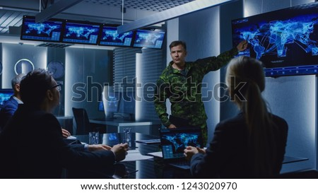High-Ranking Military Man holds a Briefing to a Team of Government Agents and Politicians, Shows Satellite Surveillance Footage. #1243020970