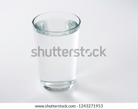 Drink water glass over sunlight on a white background #1243271953