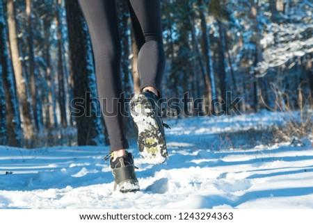 jogging in winter. running through the snow. run forest snow. #1243294363