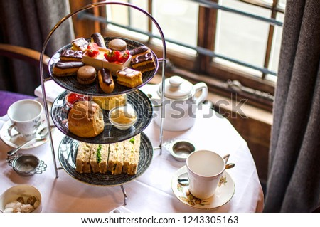 Afternoon Tea Stand with Sweet Treats Royalty-Free Stock Photo #1243305163
