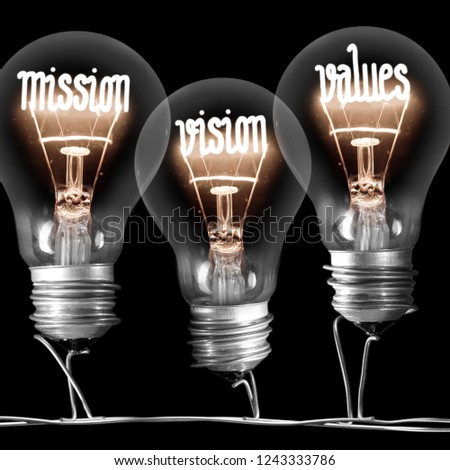 Photo of light bulbs with shining fibers in MISSION, VISION, VALUES shape on black background #1243333786