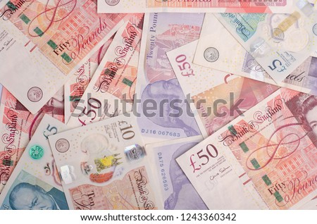 UK pound,money of United kingdom close up on white, Pound UK note Royalty-Free Stock Photo #1243360342