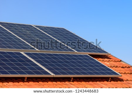 Solar panels at the top of the family house, close up. #1243448683
