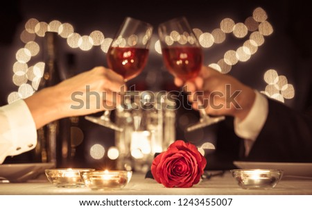Happy couple having a romantic candle light dinner.   #1243455007