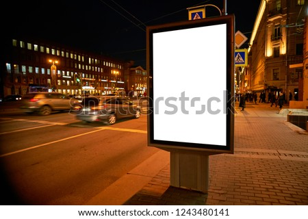 Billboard Outdoor Advertising on the street glows at night. Layout for advertising design. Outdoor Digital Sheet pylon with a white field. #1243480141