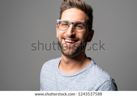A Handsome man standing over dark grey background Portrait man concept. #1243537588