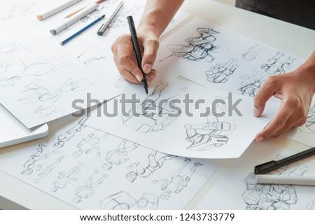Animator designer Development designing drawing sketching development creating graphic pose characters sci-fi robot Cartoon illustration animation video game film production , animation design studio. #1243733779