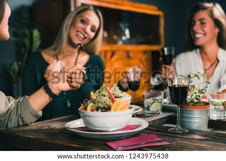 Vegetarian Restaurant. Female friends enjoying vegetarian meal in restaurant.    #1243975438