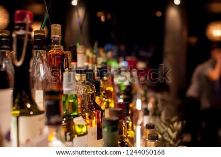Bottles of spirits and liquor at the bar #1244050168