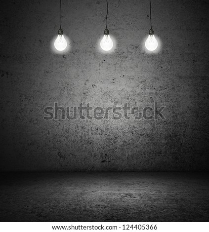 dark room with three light bulbs