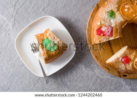 "Epiphany cake ""Roscon de Reyes"" slice on gray background. Top view #1244202460"