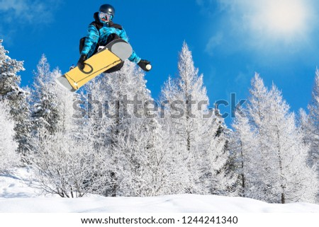jump with snowboard in fresh snow #1244241340
