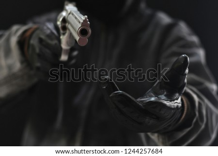Armed robbers used the gun to robbery the money, Uses Gun in Armed Robbery, Armed robbers, used for the illustration or montage of your design, Banner for advertise of product #1244257684