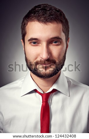 portrait of handsome man in white shirt and red necktie over grey background #124432408