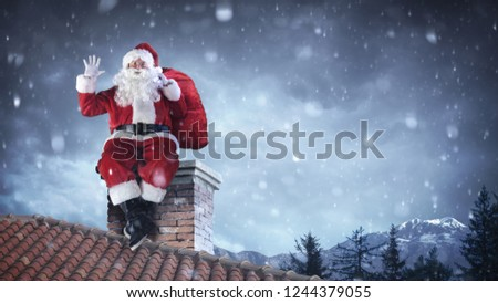 Santa Claus Greeting On Roof  #1244379055