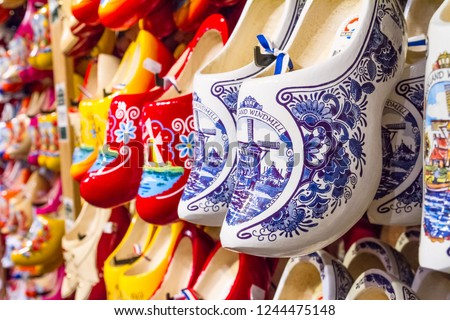 Rack in the store with rows traditional dutch wooden shoes - klompen (clogs), closeup, the Netherlands #1244475148