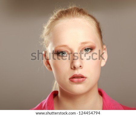 Close-up portrait of caucasian young woman isolated on beige background #124454794