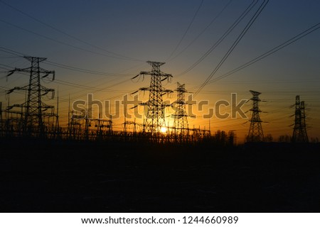 The silhouette of the evening electricity transmission pylon #1244660989