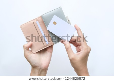 woman hand take out showing blank card for payment from pink wallet. Credit debit card with chip Royalty-Free Stock Photo #1244825872