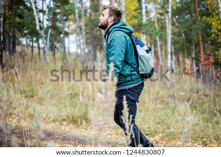 handsome male tourist hiking in the forest #1244830807
