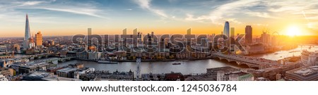 View to the skylne of London along the Thames river during sunset time, United Kingdom