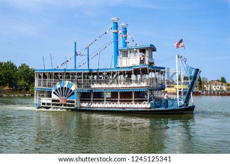 Vintage paddlwheel steamboat painted in old-fashioned American in the river #1245125341