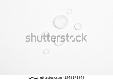 Water drops on white background, top view #1245191848