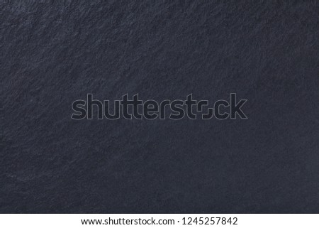 Dark gray background of natural slate. Texture black stone close up. Graphite backdrop macro #1245257842