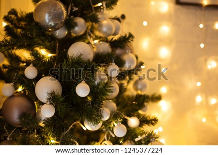 christmas room interior tree decorated by lights gifts toys candles holiday concept #1245377224